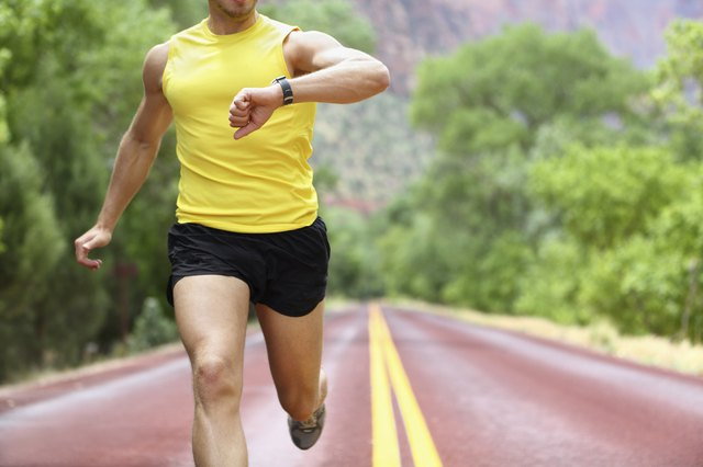 Man checks watch while jogging