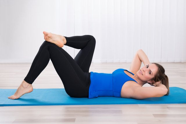 Lie on your back and concentrate on your pelvic floor muscles during Pilates.