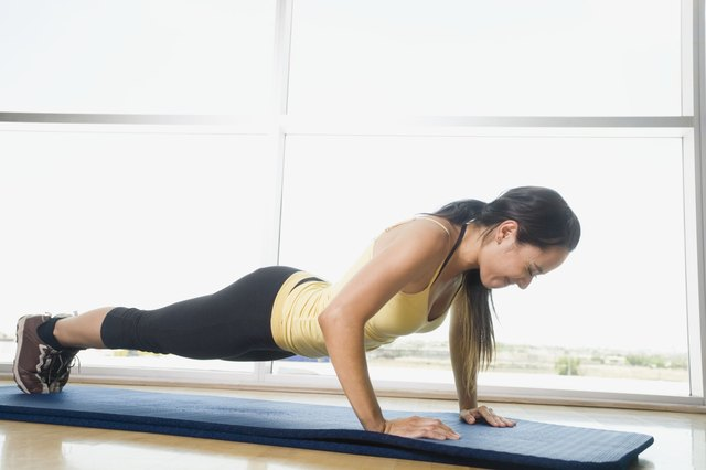 A woman doing pushups.