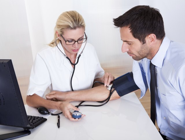 man having blood pressure taken