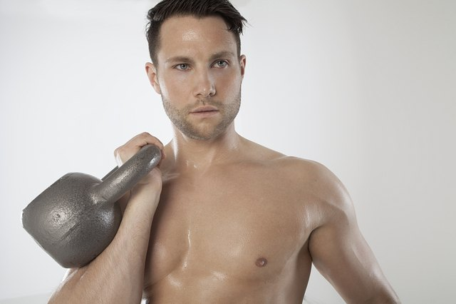 The kettlebell should rest on your wrist and fit comfortably in your palm.