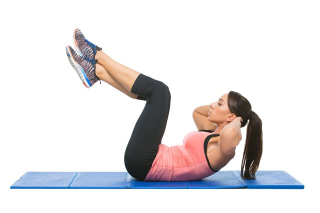 Pull your chest and knees together in the full body crunch.