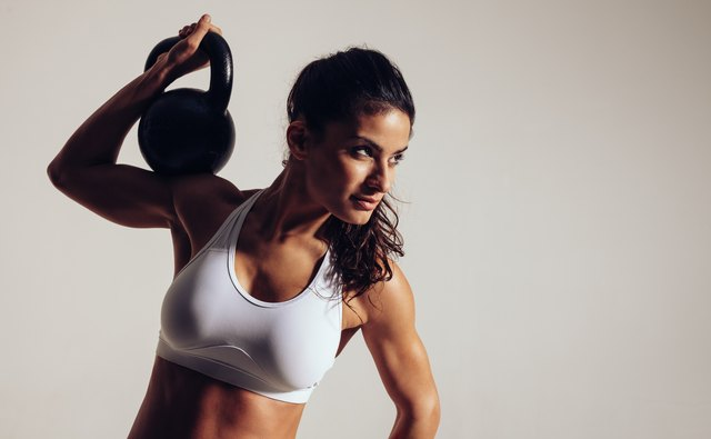 Press the kettlebell straight up for the single arm press.