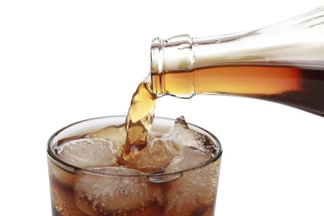Cola drinks contain sugar and carbohydrates.