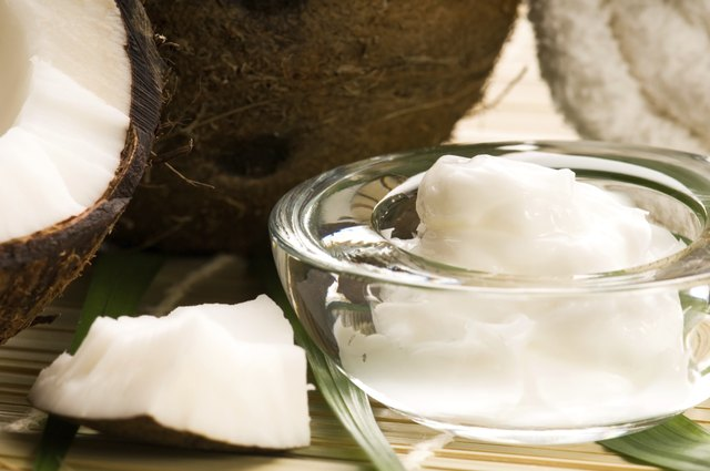 Coconut and coconut oil in glass bowl