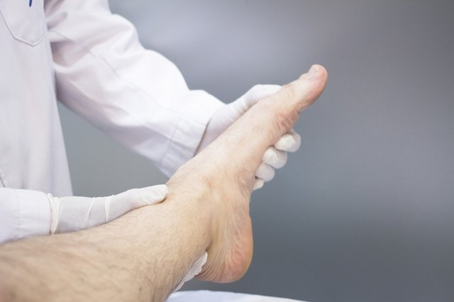 Doctor examining a patient's ankle