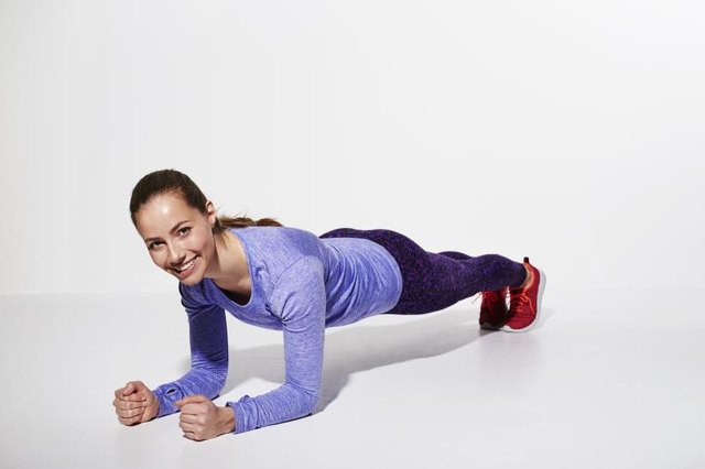 Build your core strength with a forearm plank.