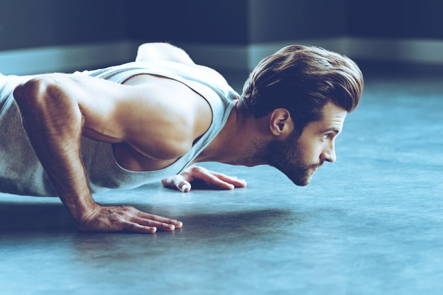 Lower your chest to the floor to reach full range of motion during a push-up.