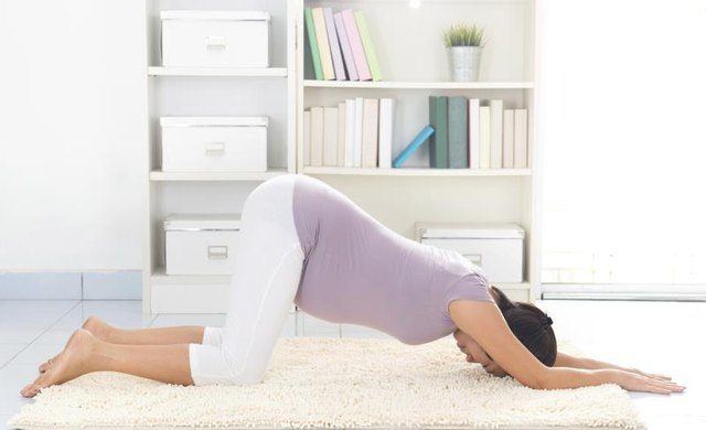 A pregnant woman experiencing groin pain