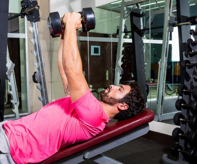 Two dumbbells and a bench have got your inner pecs covered.