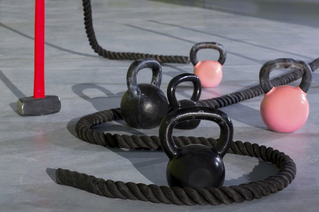 Kettlebells and ropes are standard issue CrossFit tools.