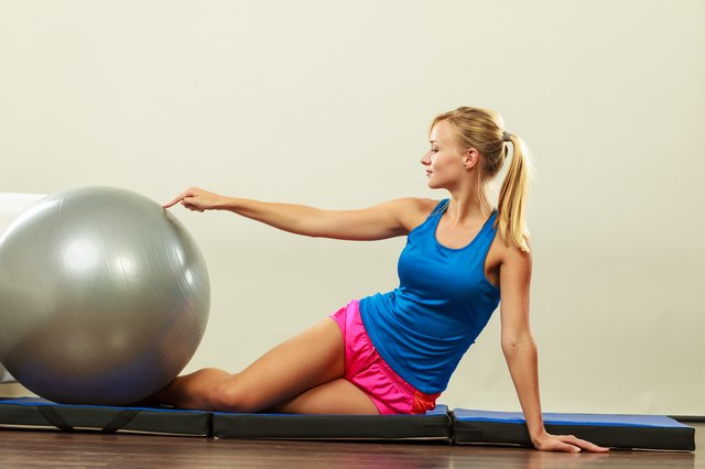 Use exercise balls to work all areas of your abs.