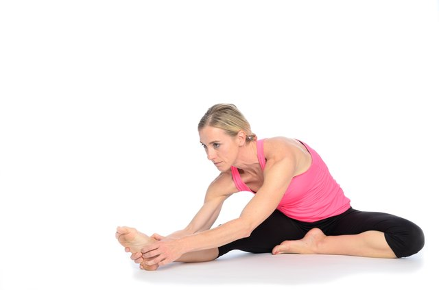Stretch one leg at a time if it is too difficult to sit with both legs straight out in front of you.