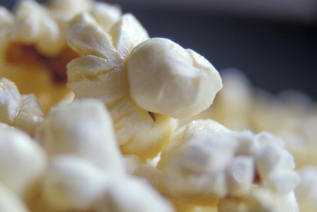 A close-up of freshly popped popcorn in a bowl.