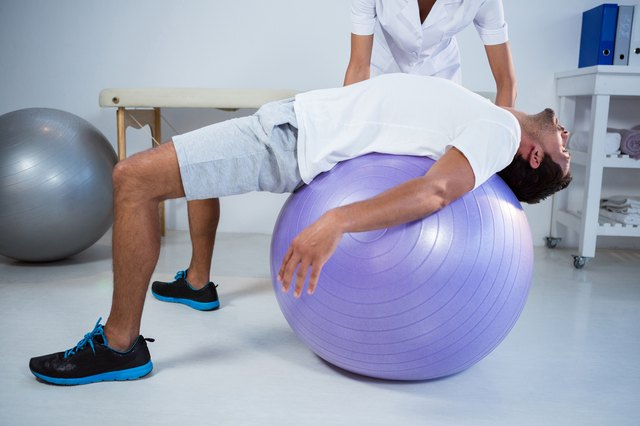 Stretch the front side of your body with a stability ball.