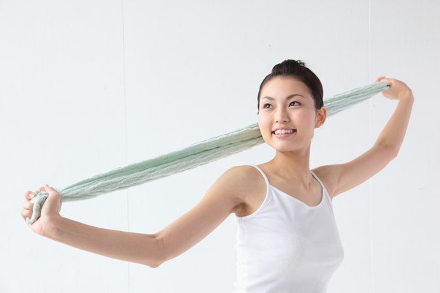Stretches can be performed with household items such as a towel.