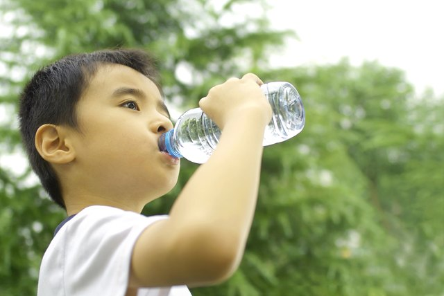 Young boy drinking water