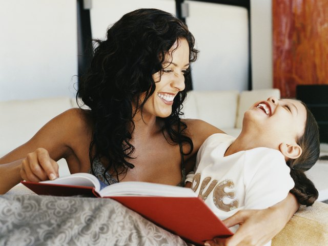 Parents can increase vocabulary and promote language development by reading books with their 2-year-old.