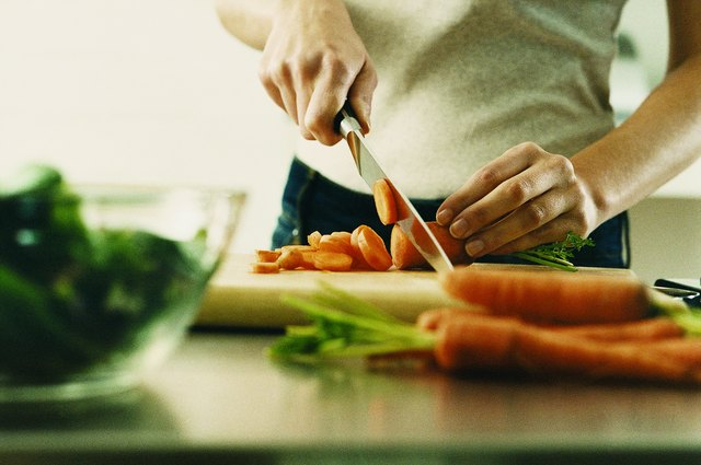 Losing body fat requires time and effort. Cut back on calories by eating foods like carrots.