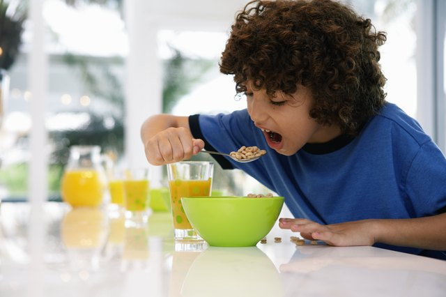 young child eating cereal