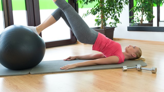 Make bridges more challenging by propping your legs on an exercise ball.