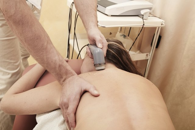 Woman having therapeutic ultrasound treatment to shoulder