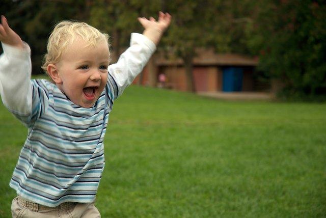 Young boy running and happy