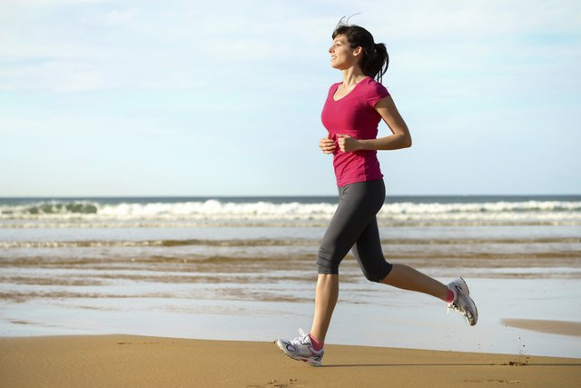 Female jogger on beach