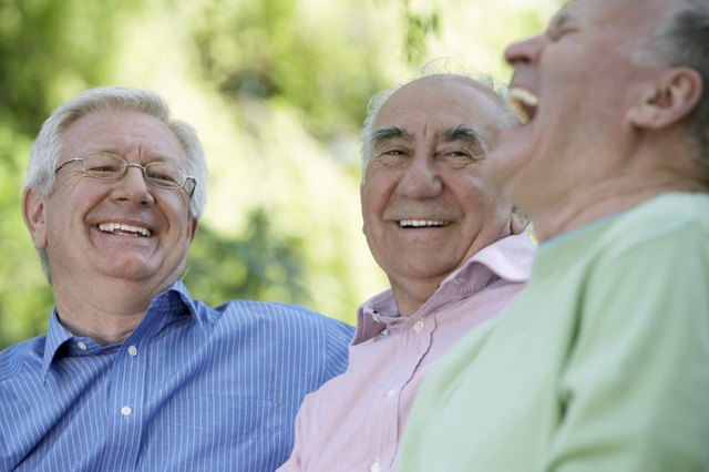 Group of older men laughing together.