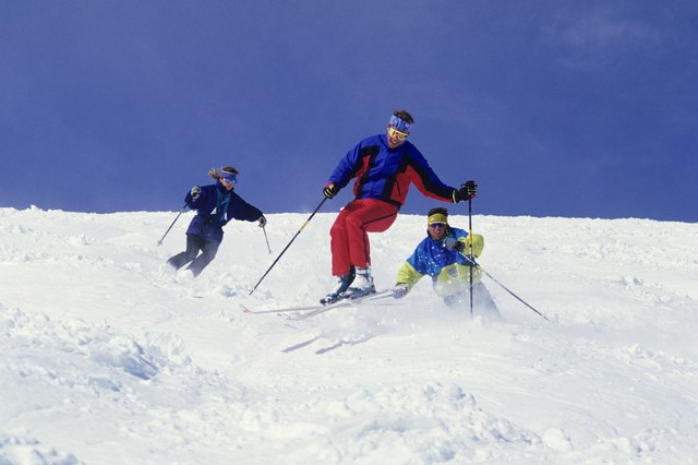 Downhill skiing is fun with friends and burns calories.
