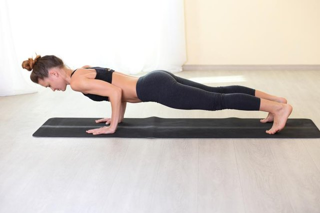 The plank pose is an ideal alternative to traditional sit-ups.