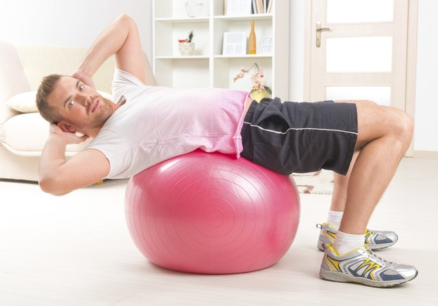 Ball sit-ups may be gentler on the hips and back.