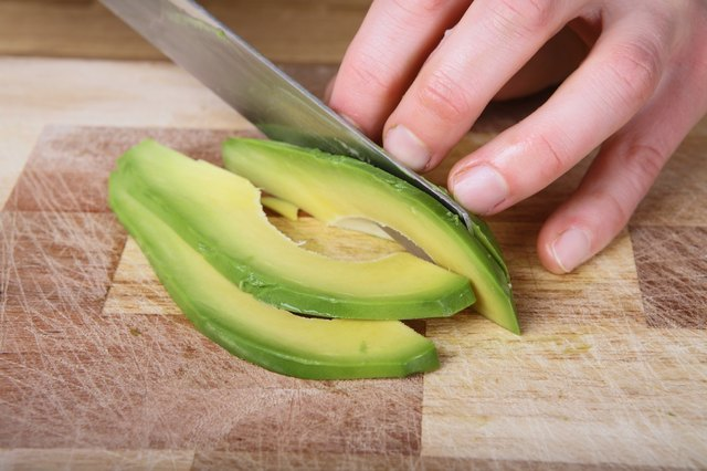 hand slicing avocado