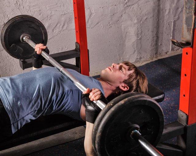Use a spotter for safety while bench pressing.