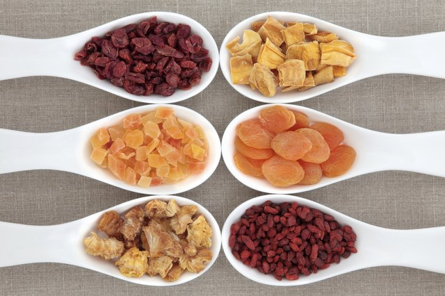 Scoops of various dried fruit