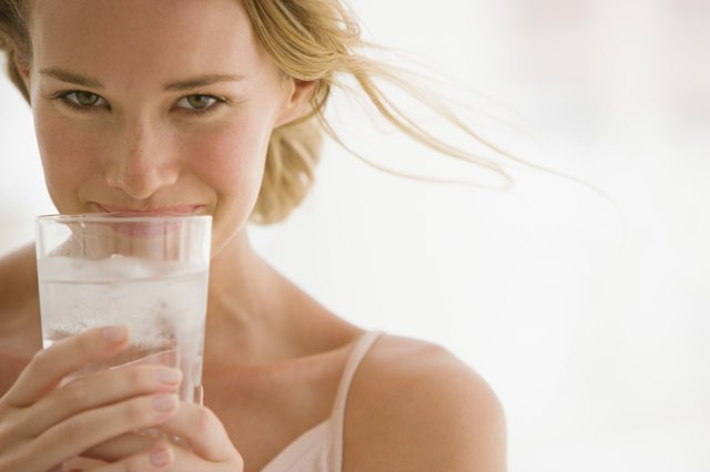Woman with glass of ice water.
