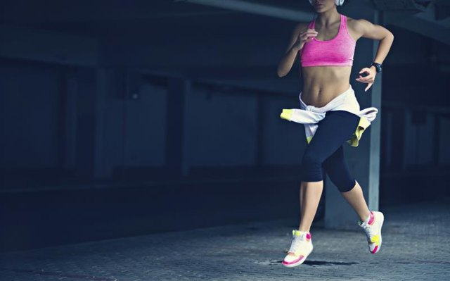 Running won't give you a six pack, but it'll help reveal your abs.