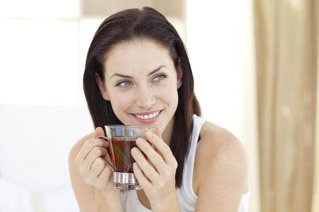 woman drinking cup of black tea