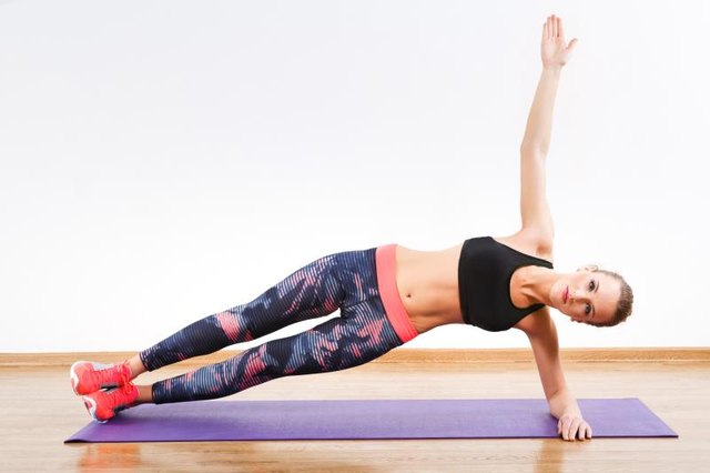 Arch your hips away from the floor in the side plank.