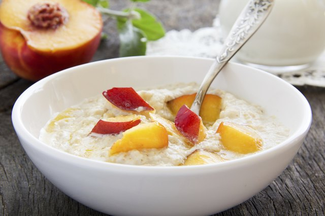 Bowl of oatmeal with peaches
