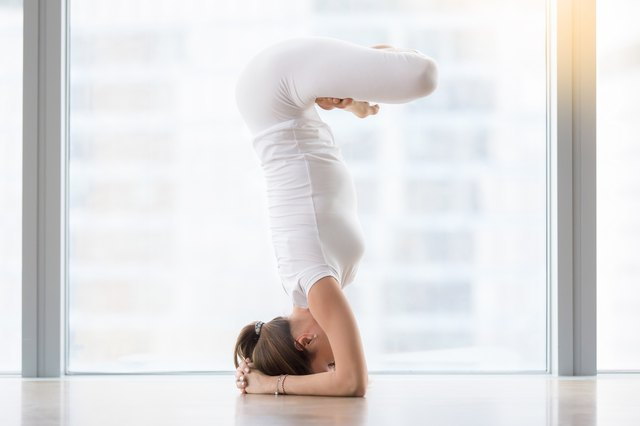 Variations of Headstand include wrapping your legs into Lotus.