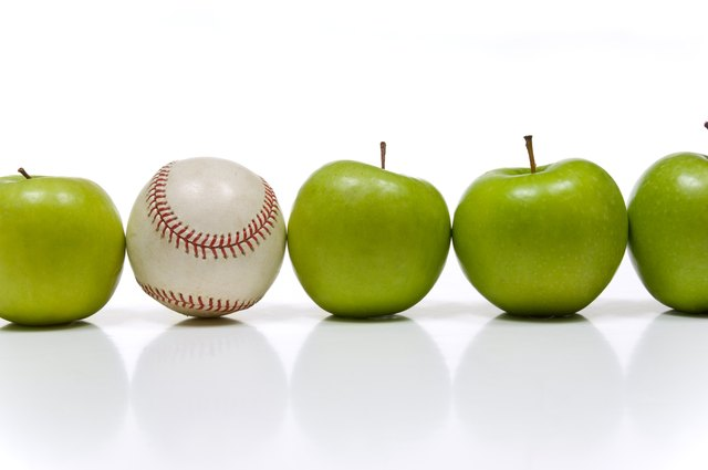 Row of apples and baseball