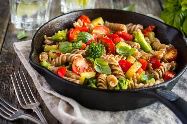 Balance out the carbs in pasta by throwing in tons of veggies.