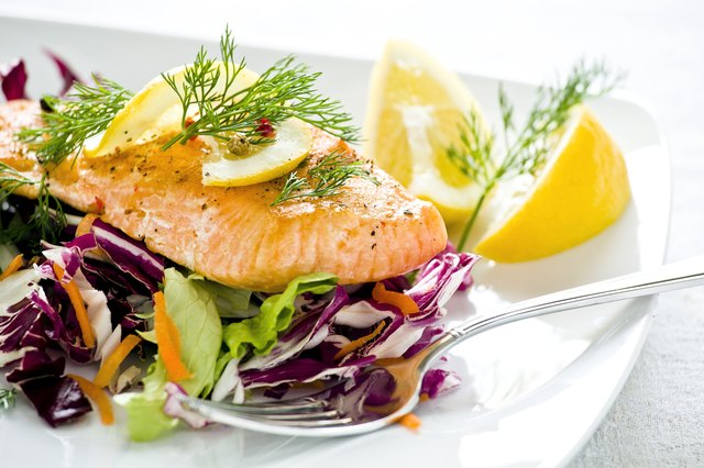 fresh salmon on top of healthily salad leaves