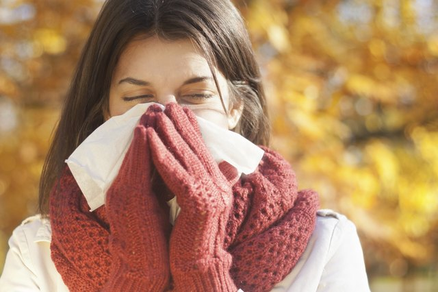 Cold symptoms can include a runny nose, headache or sore throat.