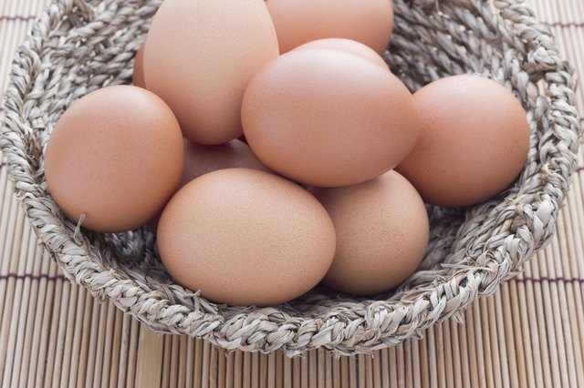 Basket full with brown eggs