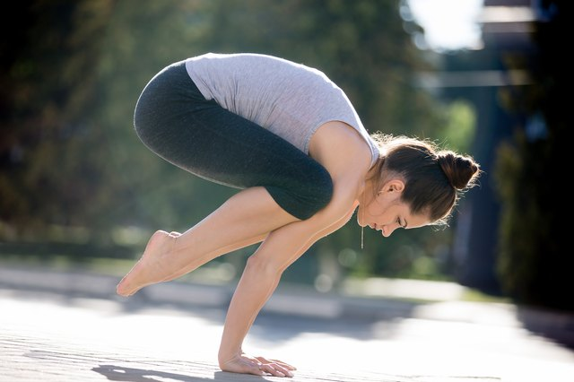 Crow pose trains your core and balance.