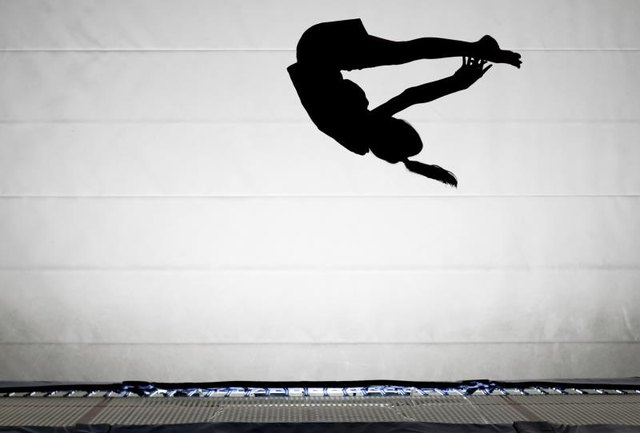 How Do You Learn to Do a Front Flip on the Ground If You Know How to Do It on a Trampoline?