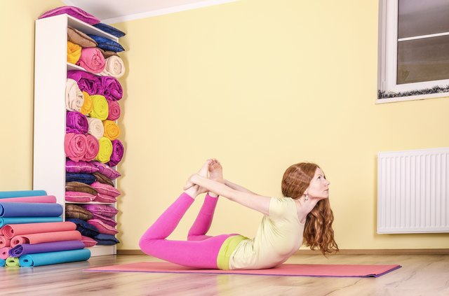 Perform Pilates exercises on a firm but padded surface.