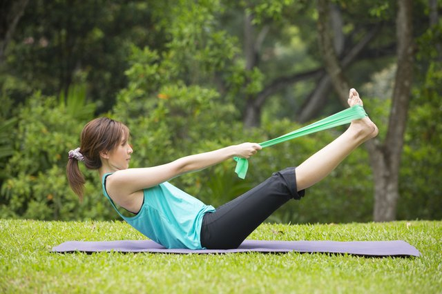 Use resistance bands to train your abs and biceps almost anywhere.